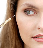 A woman prepares to receive a botox injection  (image©Rex Features )