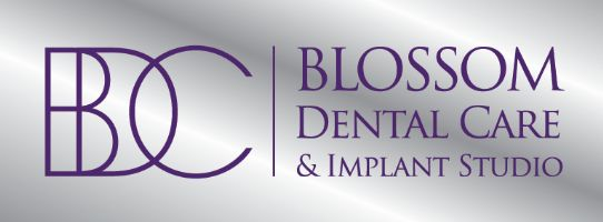 Blossom Dental Care and Implant Studio Logo